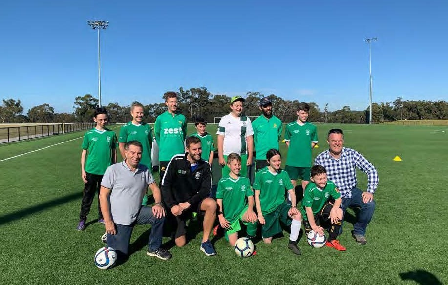 Pararoos team after match pictured with RPS staff members